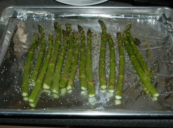 Trim asparagus ends.  Place spears onto a foil-lined cookie sheet or jelly roll...