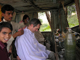 A PV gets his hair cut at the local barber's