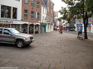 2012. No evidence of any problems with the paving in the square