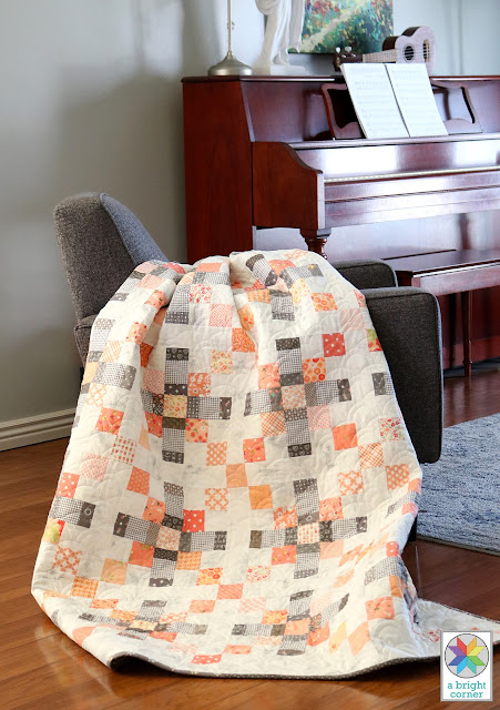 Scrappy gray and coral quilt by Andy Knowlton of A Bright Corner - pattern is from the book Season to Taste