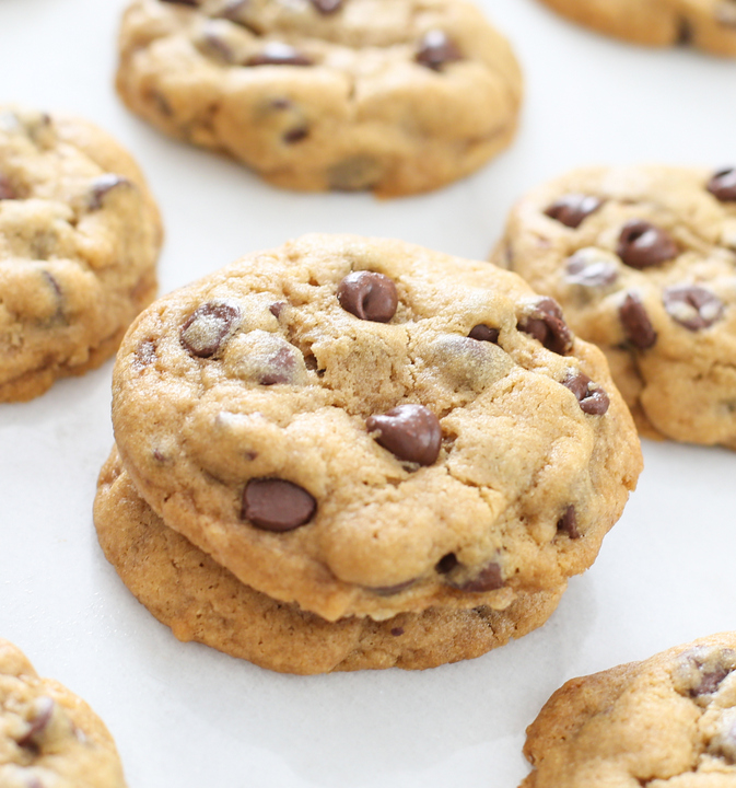 close-up photo of a stack of two chocolate chip cookies