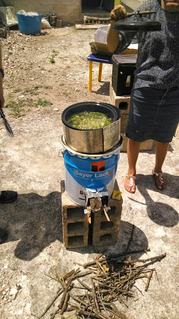 In no time, a nutritious, moringa tea is boiling, thanks to the rocket stove.