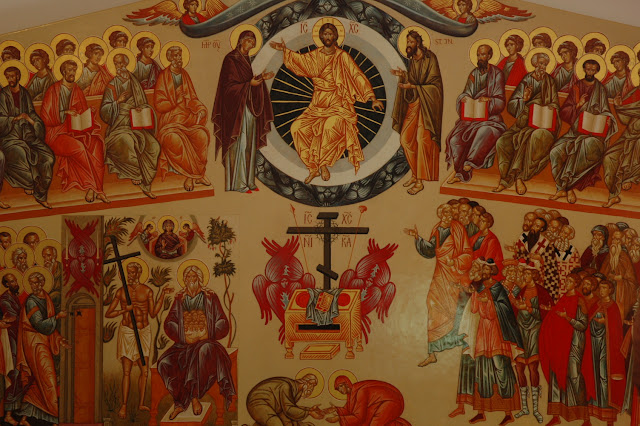 The icon features Christ enthroned in glory, flanked by the 12 disciples.  On the left is Abraham and the Wise Thief and Peter opening the door of paradise; on the right are the righteous spirits of the church.  At the bottom are Adam and Eve, symbolizing all of mankind's ability to overcome transgression and rejoin God in paradise.