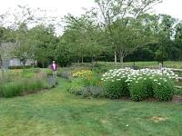 A path through perennial beds encourages a walk through the garden.