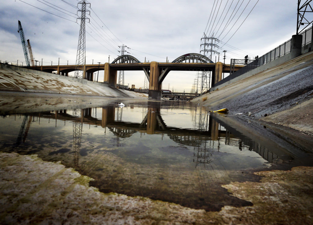 The 6th Street Bridge connecting downtown LA with its eastern districts is reflected in the Los Angeles River, 27 January 2016. Photo: Mark Ralston / AFP / Getty Images