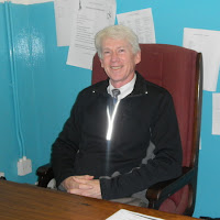Marion at his desk at the Distract Aids Coordinator office in Mochudi, Botswana