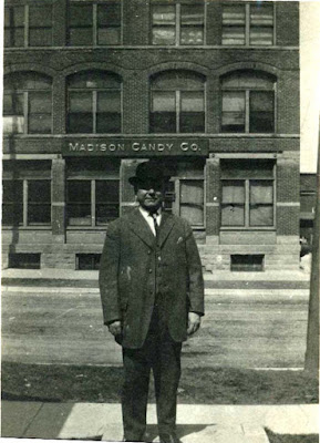 Fred Steinsberger Sr. of 743 Williamson, standing in front of the Madison Candy Company building.
