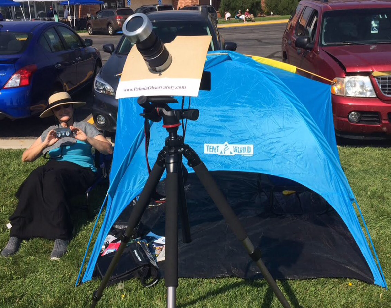 Resident Astronomer Peggy next to the observing tent and camera tripod
