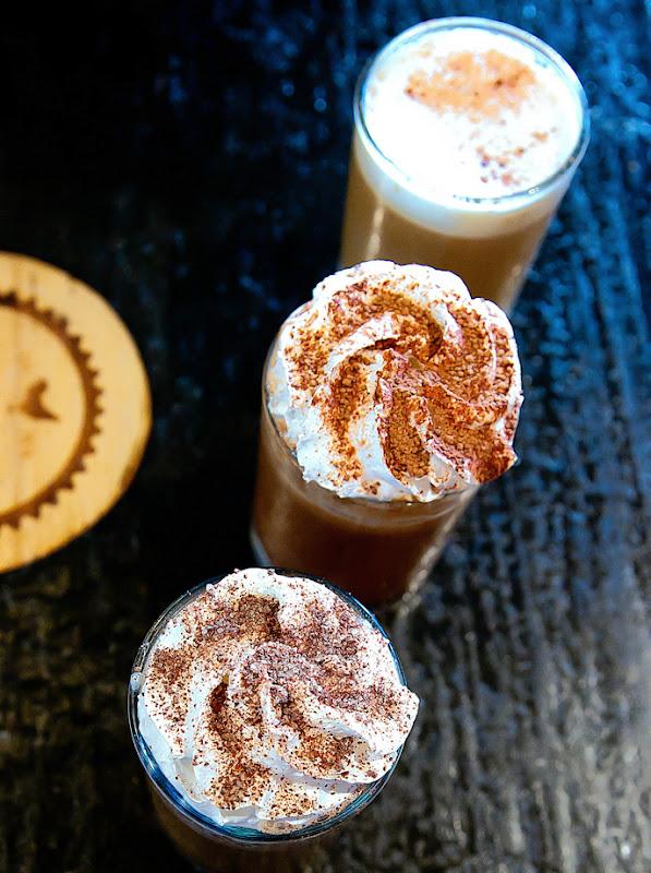 overhead photo of 3 coffee drinks served as Caffeine Overdose