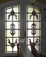 Photo: Victorian French Doors for privacy, clear double pane glass was replaced with insulated triple pane units. Red and white. Double front door entry.