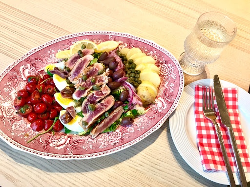 Salade Niçoise with orange marinated seared fresh tuna, pickled red onion and mustard vinaigrette