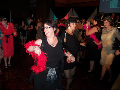 Barb Girson, keynote speaker, dancing at a Roaring 20's night at a National Conference. Photo Credit: Leslie Brown