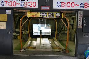Vertical parking garage lift
