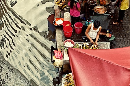 Street food hawker going strong after a massive amount of rain