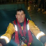 31 May 2012 - Station Mechanic Paul Taylor exits the sea survival pool after tring out the new ILB lifejacket. Photo: RNLI Poole/Dave Riley