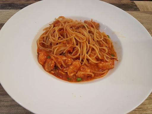 Tomato based chicken pasta from Lenas at Bugis+