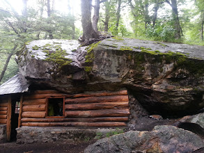 Photo: This is #RefugioPiedritas owned by the local club Andino Esnovino, fits max 8 folks, and was built under a huge #boulder. This is 3/4 of the way to #RefugioFrey, the next 1/4 is all steep climbing. You can camp near this Refugio on your own.