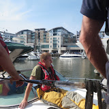 Volunteer ALB coxswain Dave Riley aboard the motor cruiser after it had been towed to Poole Quay Boat Haven. Dave checked for the cause of the water ingress - 26 July 2014.  Photo credit: Paul Taylor