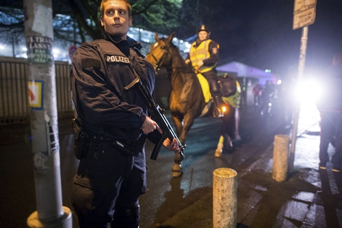 Armed police stand outside a stadium following the cancellation of the GermanyNetherlands internationl friendly soccer match due to a security threat in Hanover Germany in this November 17 2015 file photo After years of feeling insulated from militant Islamist threats Germans are worrying that they too could be subject to attacks like those suffered in Paris To match GERMANYSECURITYMOOD REUTERSMorris MacMatzenFiles