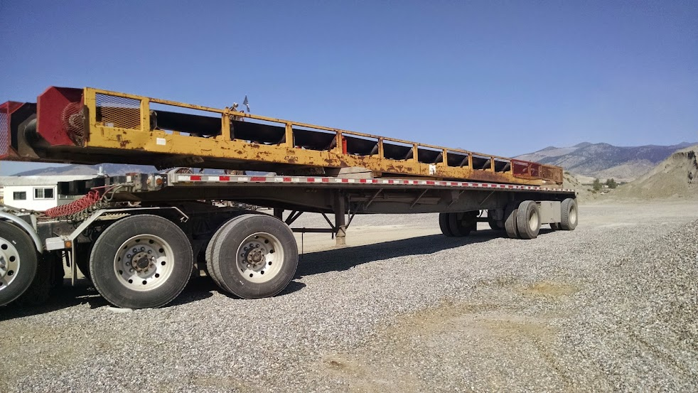 flatbed trailer loaded with rock shaker