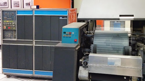 The IBM 1401 mainframe computer (left) at the Computer History Museum printing the Mandelbrot fractal on the 1403 printer (right).