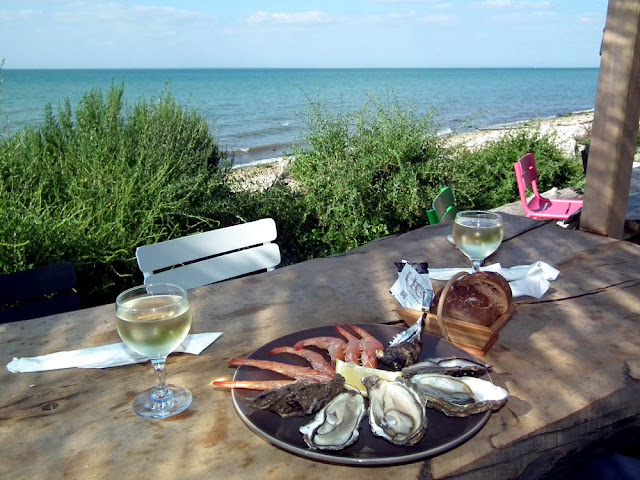 Local oysters, prawns and white wine, Ile de Ré, France. Photo by Loire Valley Time Travel.