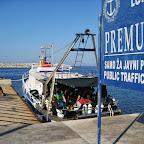 Lana in the small harbor Premua island