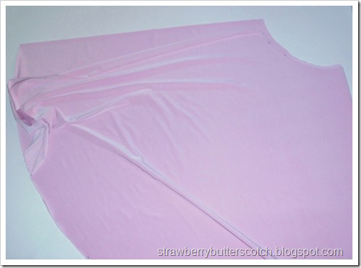 Making a pink circle skirt.