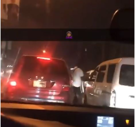 TWO ANGRY MEN PARK THEIR CARS IN THE MIDDLE OF A BUSY LAGOS ROAD TO FIGHT