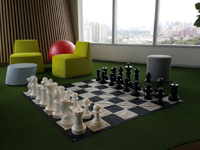 A mini garden chess set in one corner of the canteen.