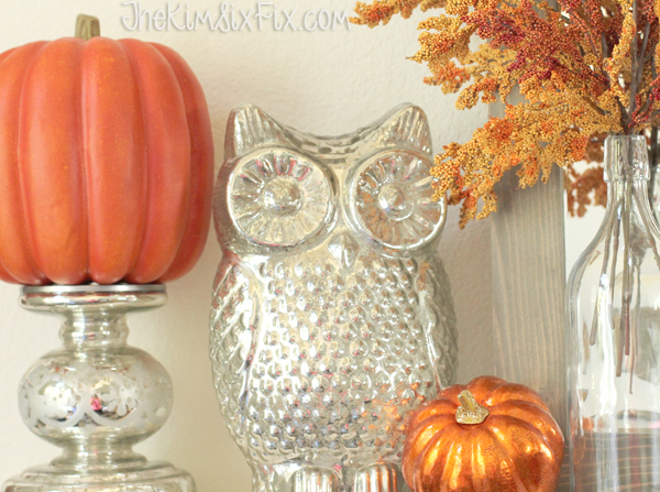 Silver owl and pumpkins