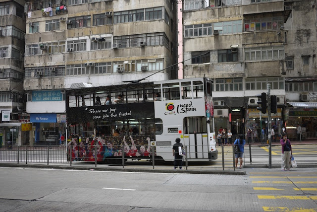 Tram in Hong Kong with Spain travel advertising