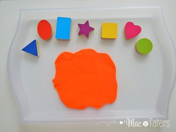 Shape Puzzle Piece Playdough Stamping: This activity is the perfect tot tray idea for your toddlers and preschoolers, especially those who love playdough.
