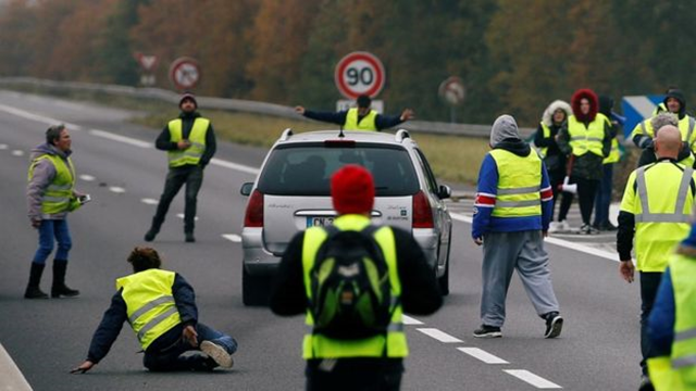 A driver forces a car through a group of protesters in Donges, western France, killing one, on 17 November 2018. Photo: Reuters