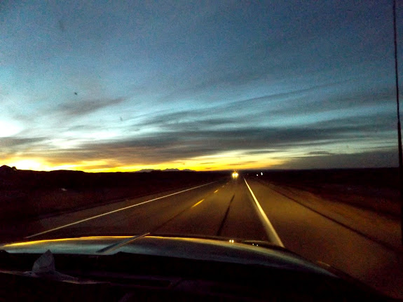 Highway 6 at sunrise with the La Sals in the distance