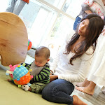 """Infant Mommy & Me classes allow babies to explore openly with quality sensory materials like this """"taggie"""" ball."""