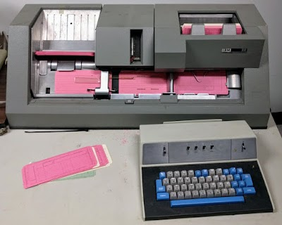 An IBM 029 keypunch in the middle of punching cards.