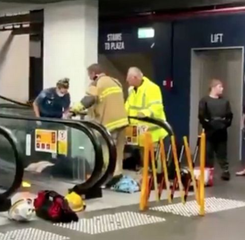 Woman gets trapped on escalator at shopping centre after freak fall (video)