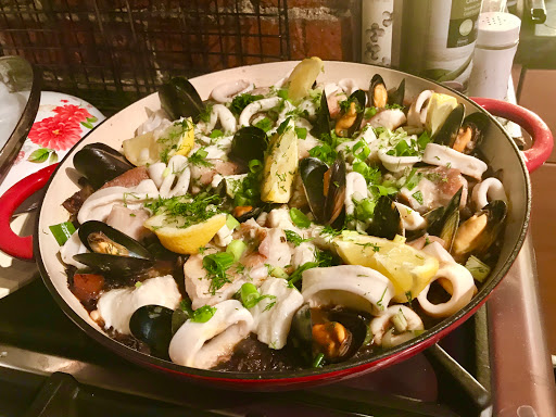 Spanish black seafood paella