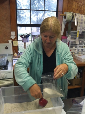Bernadette McFarling measures out lavender sugar in her workshop.