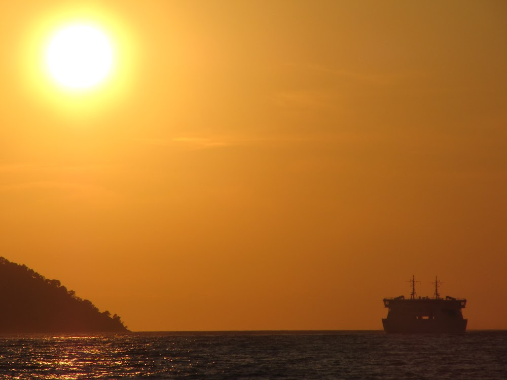 The ferry departs into the sunset…