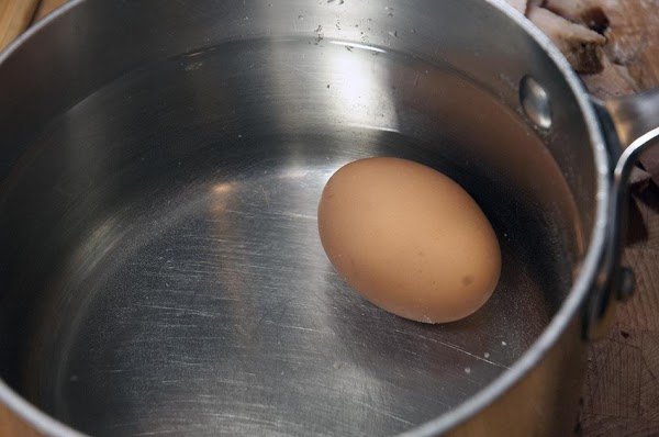 Cook the hard-boiled egg.