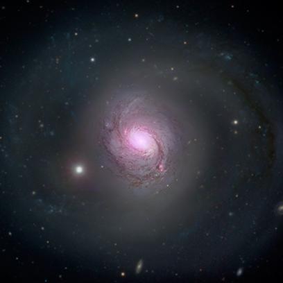 M77 no visível e em raios X