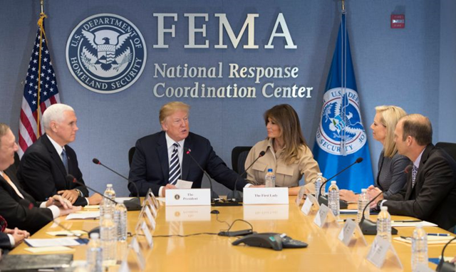 President Trump with VP Mike Pence and first lady Melania Trump at FEMA headquarters, 6 June 2018. Trump didn't mention the Harvard study that estimated more than 4,600 Americans in Puerto Rico died in Hurricane Maria and its aftermath. Photo: Jim Watson / AFP