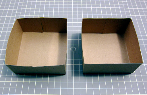 With a little bit of double-sided tape, I secured each of the small flaps to the larger flaps at either end, creating the top and bottom of my box.
