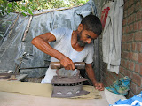 Clothes are ironed with a traditiional, coal-fired iron