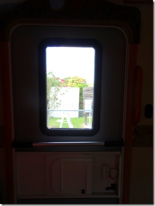 window in 5th wheel door