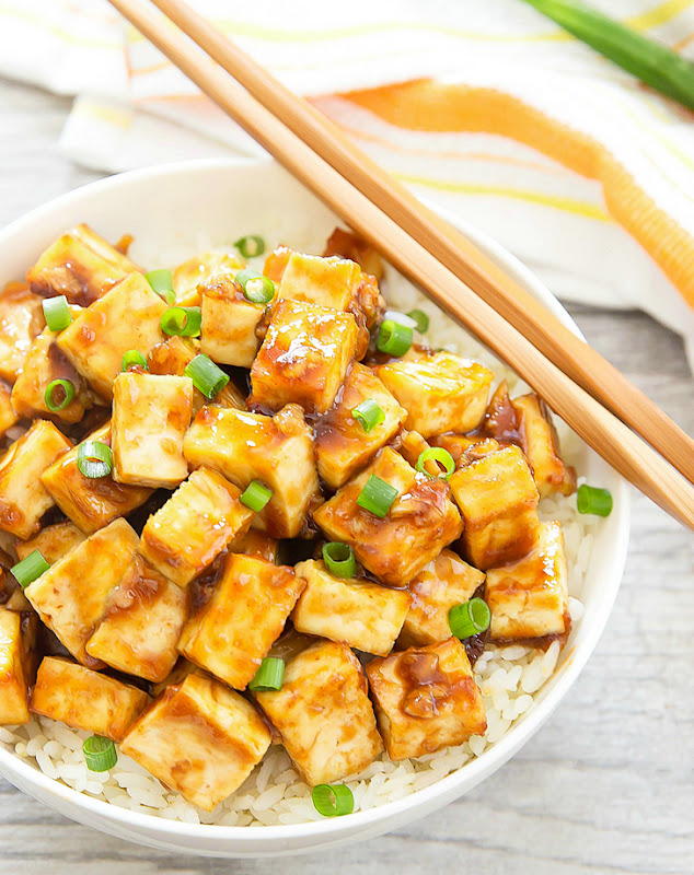 overhead photo of a bowl of Crispy Baked Garlic Tofu with chopsticks