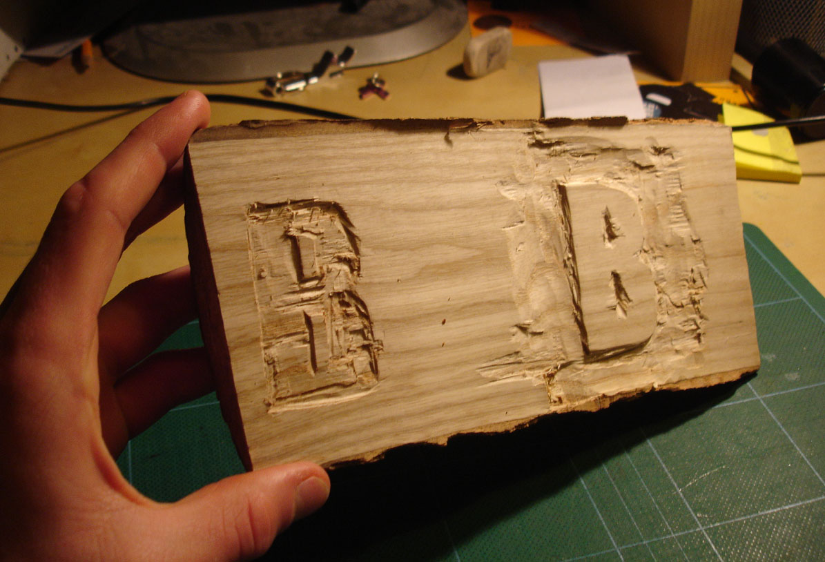another idea which i have shown in my sketchbook is to make the block out of wood and not cement by either carving the letters into the wood or carving the