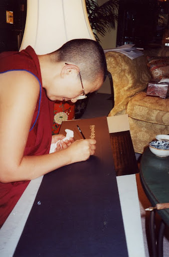 Ven.Tsen la writing the Diamond Cutter sutra in silver